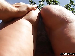 Mature slut Victoria almost caught giving head in the forest