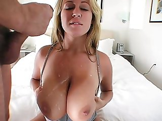Spraying a big cumshot on big natural tits