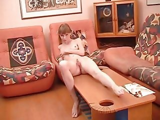 Cute skinny blonde Amy B plays on the couch
