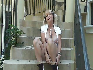 Blonde Granny with Ponytails Playing Outside