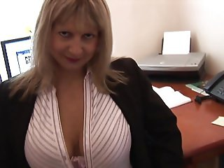 Busty blonde secretary in stockings and open girdle