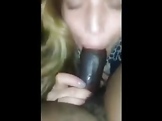 White woman with sexy lips receives a prize in her throat
