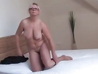 mature blonde lover fingers her hairy cunt