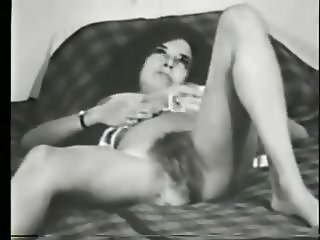 Vintage! Hairy lady in stockings on the bed.