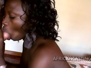 African sex queen nibbles on penis