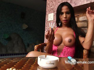 Sexy Shemale Smokes Cigarette and Rubs Herself