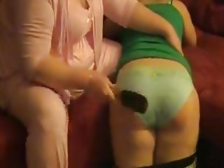 Large older woman spanking girl