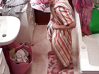 Spying on his wife in the shower 2
