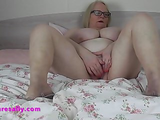 Granny shows her bare legs and wet pussy