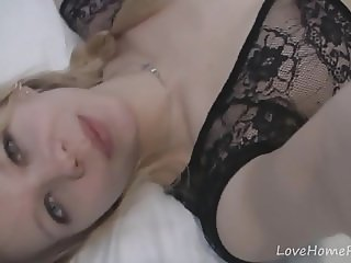 Beautiful blonde in black lingerie records herself