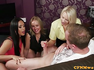 British femdoms tugging cfnm subject in group