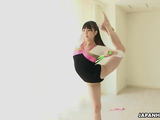 Flexible Japanese gymnast toys her cunt and dances while stripping