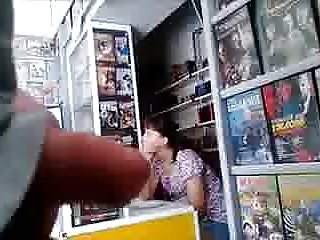 Flasher in video shop near to assistant