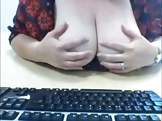Mature secretary fondles and flashes her heavy hangers