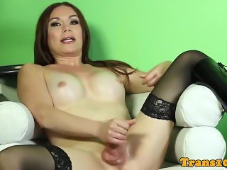 Stockinged tgirl masturbating on couch