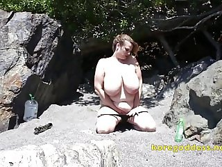 Big tits beauty down at the beach