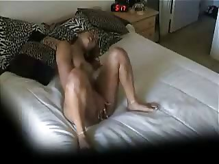 My kinky sister rubbing her pussy on bed. Hidden cam