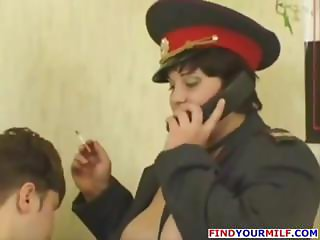 Chubby, busty brunette Russian police officer gets drilled at work
