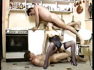sexy servant double penetration in a kitchen