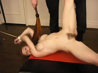 Redhead is tied up and tortured and humiliated by her master