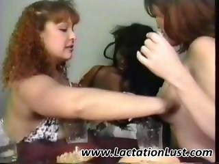 Lactating lesbians having fun milking their tits in this scene