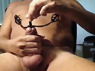 hot kinky play with nip clips and cock rod and cum shot