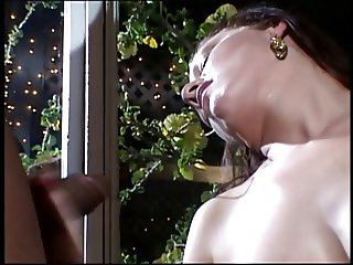 Gorgeous brunette gives black stud a handjob in house at night