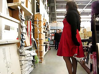 crossdresser playing in store