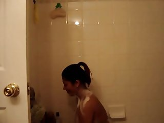 SEXY BRUNETTE TOPLESS SHOWERING DANCING