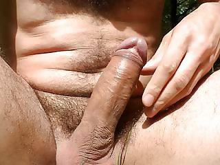 Naked cock play and cum in the sunny woods