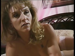 Mature and horny lady sticks anal beads up her asshole