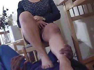 Playing with and sucking on ebony feet