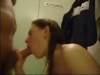 Cute brunette blows and swallows in a locker room