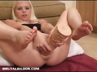 Jayda filling her pussy with a monster sized dildo