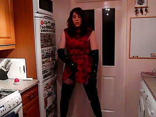 Wanking in a red dress and shiny thigh boots