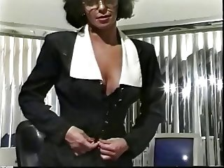 Astounding brunette in glasses is showing her pussy in the office