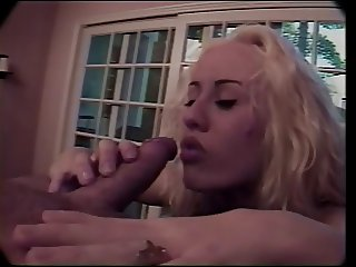 Blonde with tongue stud sucks cock in living room