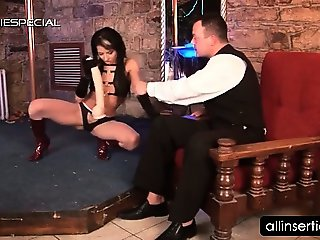 Pole dancer teases her hot assets with a dildo