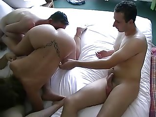 MILF takes on 3 young guys in hotel room.
