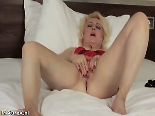 Horny blonde milf loves playing part1