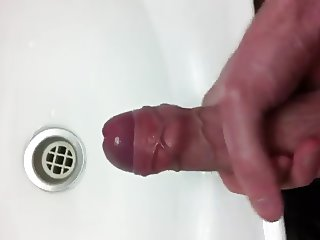 Uncut veiny cock wanking in a sink