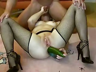 Wife with a cuncumber in the ass