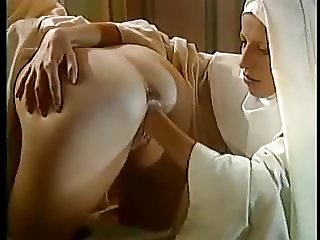 2 Nuns kissing and fisting