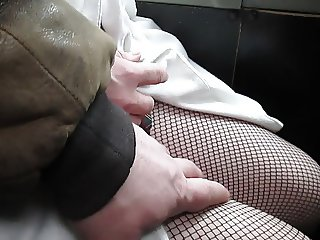 Touching her black fishnet stockings in a bus 2