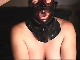 MASKED SUBMISSIVE WHORE SUCKS COCK