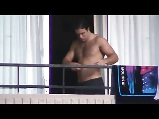 half naked and naked guys on the balcony