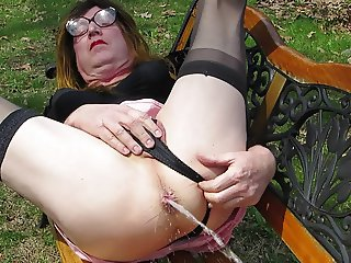 Dawn squirting on park bench outdoors, anal play