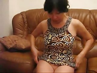 mature asian woman dressing on cam - stolen