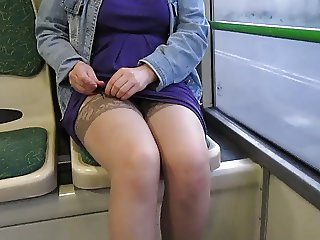 Girl checking stockings and suspenders in a bus