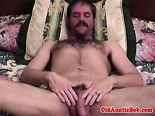 Bear with pierced ball sack wanking self